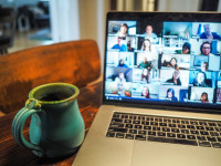 An open laptop with web conferencing on the screen